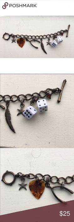 {lucky} charm bracelet LUCKY BRAND Charm Bracelet   Gold bracket with clasp at end Charms include: guitar pick, dice, wishbone, star, feather   Great condition just don't wear it ! Lucky Brand Jewelry Bracelets