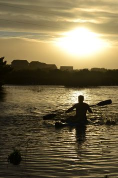 """This is definitely the """"shot of a lifetime"""" for me. I love the silhouette of my brother-in-law kayaking in the sunset!"""