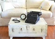 painted trunk (with feet) as a coffee table with great built in storage