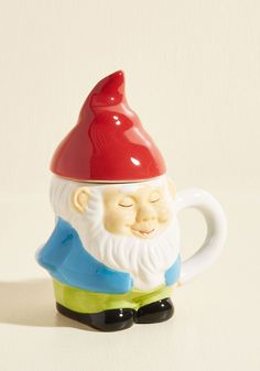 When a morning meetup with friends calls you out of bed, grab this gnome mug and start the day fresh! This ceramic fellow greets you with a serene smile, an arm as the handle, and an orange hat-turned-lid to keep your brew warm - just like your heart when you see your pals!