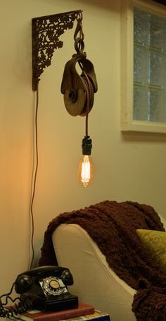 Industrial plug in lighting fixture lamp; repurposed old wooden pulley, iron bracket, cloth wiring on hanging socket;