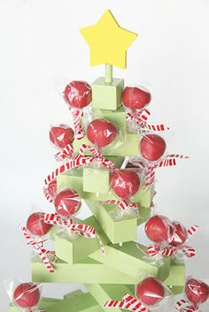 """grandpa made our """"lollipop"""" tree - painted it dark green and the slats were narrower.  Very cute with the old white and red/pink """"O"""" lollies - wrappers removed - kids LOVE it!"""