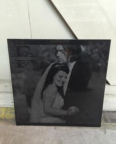 Laser etched photo onto natural stone.