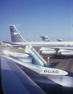 BOAC B707 and VC-10 parked at the gate at London Heathrow 1971