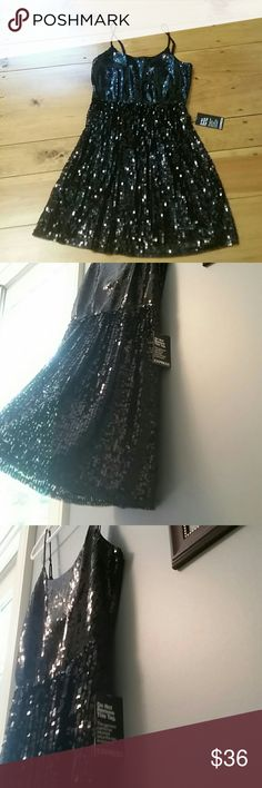 NWT Express black sequins dress Lovely Express black sequins dress with adjustable straps for a perfect fit. It has a built-in slip shown in picture 4. The adjustable straps are shown in picture 8. The top of the dress has smaller sequence which changes to larger ones at the waist. It has an elastic cinched  waist. This is size small. The dress is about 36 inches from shoulder to hem, depending on how long you make the straps. Brand new, in excellent condition. Express Dresses