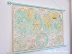 DIY:  Wall Map Tutorial - this is a great way to display an old map! Limited instructions.