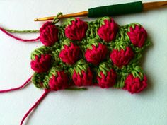 Crochet & More: Strawberry Stitch Tutorial @Audrey Burm this is so cute! Reminds me of your strawberry hats!
