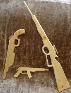 Rubber Band Guns--free scroll saw patterns. Use for shooting tin cans at western party! Great craftsman project!