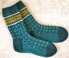 pattern 'Flattery socks' and knitted with 2 skeins of Latvian mittenKnit Picks Tidepool Heather as main colour. Inspired by Latvian Mittens and can be found on ravelry Crochet Socks, Knit Mittens, Knitting Socks, Hand Knitting, Knitting Patterns, Knit Crochet, Knit Socks, Patterned Socks, Designer Socks