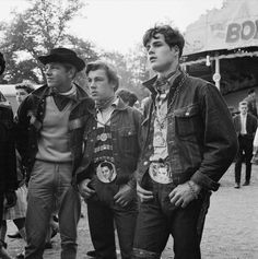 Rebellious 1960's teens wearing big Elvis belt buckles...