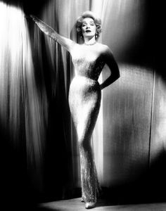 sparklejamesysparkle:  Marlene Dietrich wearing one of her fabulous Jean Louis gowns in a 1960 publicity still for her concert appearances. Photo by John Engstead.