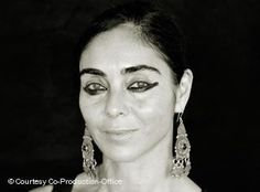 Shirin Neshat (Persian: شیرین نشاط; born March 26, 1957) is an Iranian visual artist who lives in New York City. She is known primarily for her work in film, video and photography.