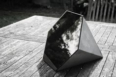 Hexagonal mirror, part of studiokyss concrete deskware range, 2013.