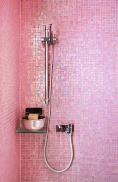 Do your little a favor.  Remodel and let her clean off in this naughty but nice pink shower. Pearlescent pink glass mosaic tile in the shower #fashion #girly #lifestyle