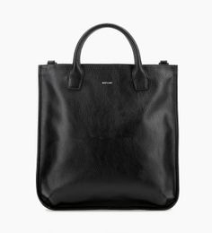 "100% VEGAN. Dwell Collection. Tote that can be worn as a handbag or crossbody, with adjustable and removable strap. Zippered top closure. Shoulder strap drop: 19.5"" (49.5 cm). Handle drop: 4.5"" (11.5 cm). Interior: zipper pocket, slip pocket, logo-embossed cork tag. 100% recycled nylon lining. Dimensions: 16.5"" X 17"" X 3.5"" (42 cm X 43 cm X 9 cm)."