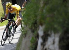 Sky Procycling rider and leader's yellow jersey Wiggins of Britain cycles during the eighth stage of the 99th Tour de France cycling race between Belfort and Porrentruy. BOGDAN CRISTEL/REUTERS