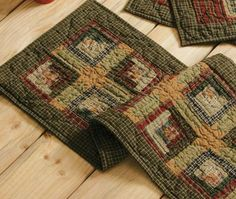 "The Tea Cabin Quilted Runner 13x36"" collection is one of my favorites. I love the log cabin pattern and rich color. This would be great on your dining table, mantle or hutch. https://www.primitivestarquiltshop.com/products/tea-cabin-quilted-runner-13x36 #primitivekitchensandddiningrooms"