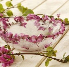 Freeze flowers in water between 2 bowls to make an Ice Bowl  Use as decorative serving dish to keep food chilled