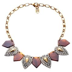 Stunning handmade necklace, showcasing tortoiseshell-inspired accents highlighted by sparkling rhinestone pendants and rich gold plating.