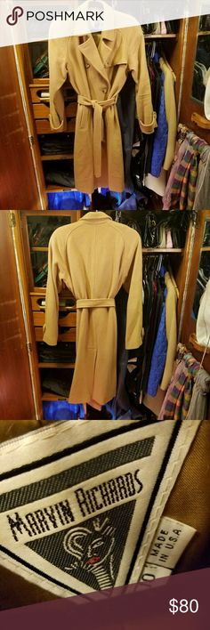 MARVIN RICHARDS vintage coat In a classic camel color. 100% wool. Beautifully styled with button tabbed cuffs, notched collar, fully lined & belted...very nicely done.  There are a couple small spots that have been worn (the biggest one is in the pictures), and can be repaired if that's what you choose to do. MARVIN RICHARDS  Jackets & Coats Trench Coats