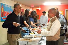 President Obama and family serve Thanksgiving meals to homeless and at-risk veterans at Friendship Place on Nov. 25, 2015, in Washington.