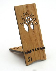Cherry iPhone Wood Stand $26.00  Whether you use your phone as your alarm clock and want it sitting on your bedside table, or you want things looking tidy while charging, this piece is useful and attractive. Handcrafted in the U.S.A. Laser cut cherry wood Sustainably harvested 6 x 2.5