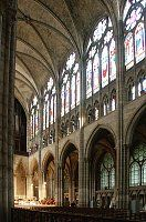 The three-story nave elevation has a narrow triforium between the arcade and clerestory. (Basilica of St. Denis, Paris)