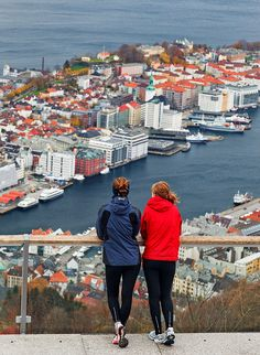 A couple of athletes enjoy the view over Bergen from Mount Floyen. Numerous paths offer easy walks to the top through woodland terrain surrounded by lakes and mountains. An easier option is to take the famous Funicular to the top. Norway Sweden Finland, Denmark, Bergen, Oslo, Beautiful Norway, Alaska, Beautiful Sites, Andorra, Amazing