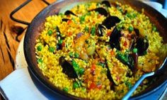 Paella comes in so many varieties: vegetarian, seafood and traditional with all the fixings.
