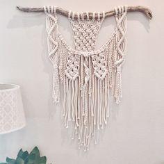 A personal favorite from my Etsy shop https://www.etsy.com/listing/488679305/bohemian-modern-macrame-wall-hanging