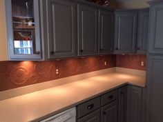 DIY Kitchen Backsplash - I really wanted a unique, copper backsplash but that wasn't in the budget. I decided to create my own using foam boa