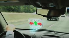 Researchers have developed virtual traffic lights that show up on windshields when needed, and disappear once a junction is crossed.