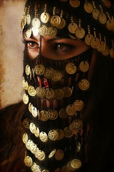 A woman wearing an Egyptian bought Buraq / her culture sees it as beautiful; I see it as confinement