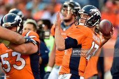 Quarterback Trevor Siemian #13 of the Denver Broncos warms up before taking on…