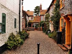 typical Norfolk England Vobbled Flintstone houses, these are in Blakeney, UK;  by saxonfenken, via Flickr