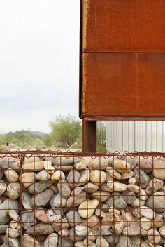 corten cladding with gab ion wall. detail of Desert Broom Library by Richard + Bauer. Stone Retaining Wall, Gabion Wall, Retaining Walls, Architecture Details, Landscape Architecture, Steel Cladding, Arch Building, Architectural Materials, Weathering Steel