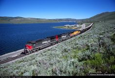 A Southern Pacific AC4400CW leads an Intermountain Power to Skyline coal train along the shoreline of Scofield Reservoir on June 23, 1997.