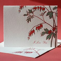 Two ladybugs cavort beneath strands of heart-shaped flowers. At Painted Tongue Press we think it's okay to be a bleeding heart once in awhile if it means sending a card to someone you love.    This card is also available as a blank note. $5