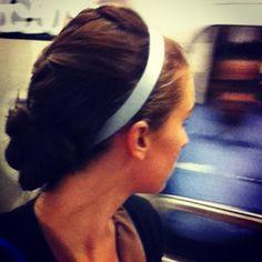French braided bun with a mint Goody headband. Mist with Oribe Apres Beach Spray for texture!