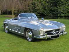 1957 Mercedes 300SL Roadster.  Although not as famous as its Gullwing predecessor ('55 - '57), the roadster provides even more beautiful lines (arguably).  Production of the convertible ran from 1957 to 1963.  Pricewise... pretty much untouchable in the hundreds of thousands.