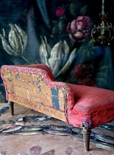 Child's velvet settee in front of a hand painting red backdrop by Jennifer Lanne
