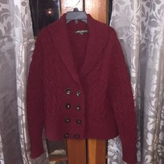 Eddie Bauer Angora & Wool Peacoat!!  Eddie Bauer (see pic for actual material percentages) Wool & Angora Burgundy Peacoat W all real buttons. Very WARM?!! (Just for pic of it I was burning up lol) Very Nice Peice worn ONCE. At an amazing price?! Reminder to click on my thanksgiving basket?!! To see info about my BOGO special... It's crazy?!! Lol  Thx my fellow Posh Fam!! Eddie Bauer Jackets & Coats Pea Coats