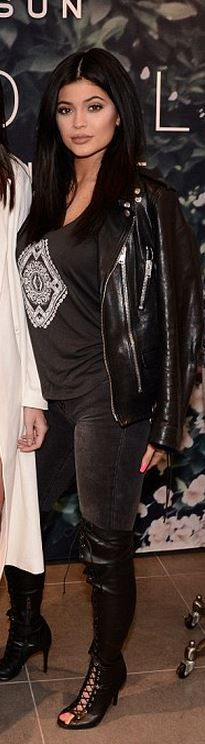 Who made  Kylie Jenner's black print tee, boots, gray skinny jeans, and leather jacket?