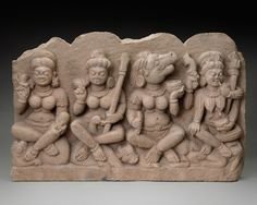 "4 of the 7 Matrikas ""Mother"" Deities, Indrani, the energy of Indra with thunderbolt and on an elephant; Kumari, the female aspect of Skanda (also known as Kumara) with a spear on a peacock; Varahi an aspect of the boar–headed Varaha with skull–cup on a buffalo; and Chamunda (a form of Kali) holds a skull–cap and a trident and sits on a corpse. Missing: Brahmami; Maheshvari linked to Shiva; Vaishnavi. They fought the Demons with Durga."