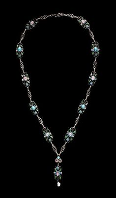 Georgie and Arthur Gaskin. Arts and Crafts necklace. Silver and enamel, set with tourmalines, turquoise with a baroque pearl drop. In the collection of Birmingham Museum and Art Gallery.