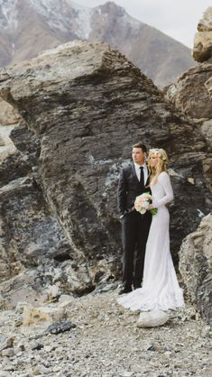 Bridal photo with long sleeved lace wedding dress. Flower crown bridal hair.