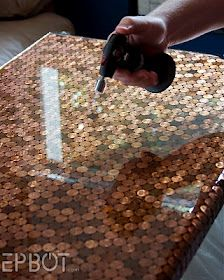 Penny tiling. I'm fascinated but I can't imagine ever doing it. For this desk top they bent pennies into curves for the front edge. Ugh.