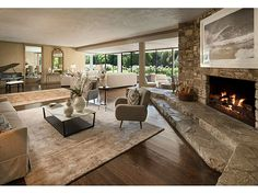 Bob Hope's living room in his Toluca Lake home.  Love the idea of creating a larger than large fireplace with a stepped hearth that acts as extra seating.  I really am dreaming!