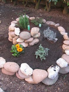 Spiral rock garden. Add height and points of interest. Gardens don't have to be a cascade of tall-to-short plants.
