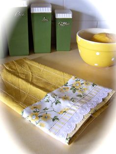 Yellow and white tea towel with Roses and lace.